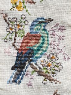 cross stitch blue green bird