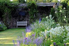 THE RESTORED DOUBLE HERBACEOUS BORDER TO THE EXTERIOR OF HIGH GLANAU MANOR