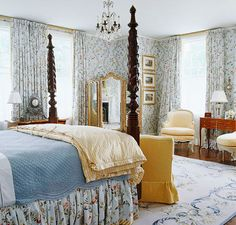 Blue & Yellow Floral Bedroom  Janet Allen and Lee Barlow designed this serene setting for the Pilgrim Hall Museum Designer Showhouse in Marshfield, Massachusetts. To play up the home's historic significance while hiding its flaws (like uneven walls and ceilings), the designers chose a classic misty-blue French floral wallpaper to envelop the room. An antique four-poster bed, yellow-checked comforter, and refined French furniture add to the room's vintage glory.