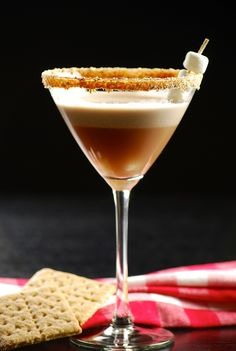 Martini 4 ounces fluffed marshmallow vodka 1 ounce crème de cacao 1 teaspoon chocolate syrup, plus extra for rim 2 tablespoons Cool Whip graham cracker crumbs Fall Drinks, Party Drinks, Cocktail Drinks, Mixed Drinks, Cocktail Recipes, Alcoholic Drinks, Beverages, Drink Recipes, Winter Cocktails