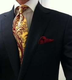 Bold Yellow and burgundy paisley tie paired with midnight blue suit and burgundy pocket square