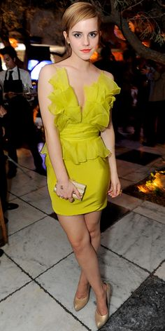Emma Watson. June 6, 2011 - For the MTV Movie Awards after-party, Watson slipped into a lime Marchesa dress, Jamie Wolf earrings, a Cathy Waterman ring, Judith Leiber clutch and metallic Salvatore Ferragamo pumps.