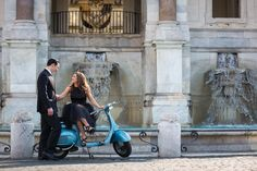 Coupe engagement photography sitting on a #vespa during a photo shoot in Rome Italy. Image by Andrea Matone photography studio. https://www.andreamatone.com #engagementrome #romeengagement #romephotographer #photographerinrome