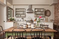 beautiful shabby chic farmhouse kitchen with over-sized kitchen table.