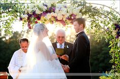 Wedding at Angus Barn Pavilion on patio by pond, flowers by Artfully Arranged