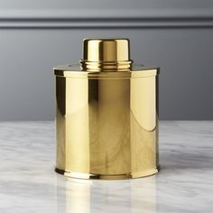 Shop Gold Tea Tin.   Glam tea canister is always ready for high tea.  Made of shiny gold stainless steel, low profile canister tightly seals loose via removable lid.  Pair with our Gold Tea Infuser.  Gold Tea Tin is a CB2 exclusive.