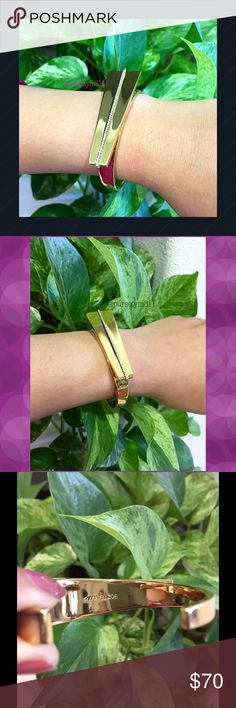 🎉HP🎉Authentic Rachel Zoe Cuff Gold Bangle 💯% AUTHENTIC ✨ A glimmering line of cubic zirconia shoots across the bold, blocky setting atop this edgy statement cuff from Rachel Zoe💖 This is the Melina Asymmetrical Cuff💖 Good condition. NO TRADE ❌ Rachel Zoe Jewelry Bracelets