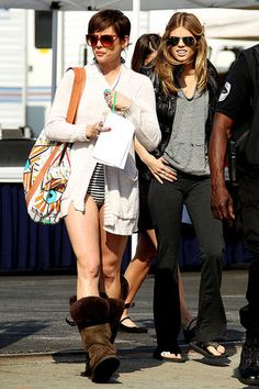 Jessica Stroup on the set of '90210' - I want her boots! Isn't it sort of funny how she's wearing those boots with a bikini while AnnaLynne McCord is fully dressed and wearing flip-flops? No? Okay. I still want Jessica's boots.