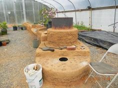 A rocket mass heater is an inexpensive way to heat your greenhouse during those cold winter months.