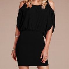 Victoria's Secret black cold shoulder dress Victoria's Secret Moda International cold shoulder dress in black. Loose up top and fitted at the waist, ties in the back. Will fit an XS or small. Worn once Moda International Dresses Mini