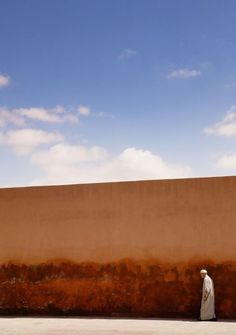 """""""Along the walls of the Marrakesh Medina. (42x59cm)"""" by Tom Hanslien. Colour photograph on Paper, Subject: Architecture and cityscapes, Graphic style, From a limited edition of 50, Signed and numbered on the front, This artwork is sold unframed, Size: 42 x 59.4 x 0.1 cm (unframed), 16.54 x 23.39 x 0.04 in (unframed), Materials: Hahnemuhle Pearl - 285 gsm. semi-gloss finish."""