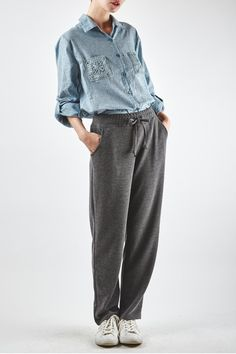 Yuki Tokyo Perrie Jogger Trousers in grey or black.  Smart yet casual easy to wear jogger trousers.  They look great with pumps for the day.  Comfortable elasticated waistband.  One size fits: 812.  Fabric: 90% Rayon 10% Spandex.  Machine wash cool or hand wash. Perrie Jogger Trousers by Yuki Tokyo. Clothing - Bottoms - Pants & Leggings Crouch End Haringey North London London