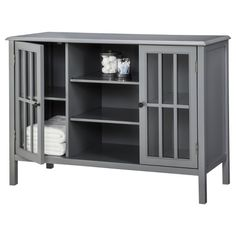 The teal Threshold Windham 2 Door Cabinet with Center Shelves emulates classic sophistication, yet is designed to meet the needs of a modern home. With many storage options, it can be used in any r… Door Storage, Storage Shelves, Locker Storage, Glass Shelves, Display Shelves, Storage Ideas, Door Shelves, Storage Trunk, Display Cabinets