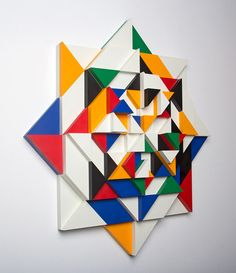 A body of work by Matt W. Moore that takes the bold, graphic elements he's known for and puts a 3D spin on them resulting in colorful, geometric mosaics.