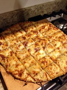 """This is the best pizza dough recipe I have found (I have tried about 10 different recipes) follow the link to her """"go to pizza dough"""" recipe in the description before the cheesy bread recipe, follow the directions exactly, it will turn out perfect! Chewy, light, deliciousness! The cheesy bread is great too, I paired it with some marinara sauce for dipping."""