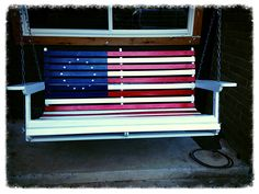 Patriotic flag.   Porch swing.   Our daughter thought it needed a new coat of paint in red, white, and blue!!