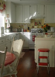 white cabinets with yellow and red accents