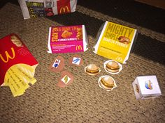 Chrisitine Davis- McDonald's speech game  This game can be used for preschool up to fifth grade. It can also work on multiple targets such as language and articulation. The materials are a die, paper chicken nuggets, hamburgers and french fries. The materials can be adjusted to target multiple targets. The picture shown targets WH questions categorizations and sequencing. This is good for a group that may have multiple goals that need to be addressed in the session. It is also a motivator.