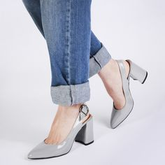 Lights camera action! It's the shoe we've all be waiting for. Lydia's a classy bae. Patent faux leather gives these a luxurious finish. Pointed toe elgogates the leg, while the slingback with adjustable buckle keeps these from being a plain old court. We've added a super chunky flared block heel to up the ante. Where these with a cropped style jean and crisp white shirt to keep the look smart but cool. Bring in the accessories!!   Heel Height: 3.5\