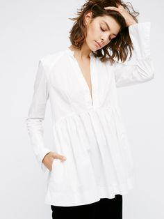 With You Tunic | American made cotton tunic featuring a deep plunging neckline and a babydoll shape. Bell shaped sleeves with button closures. Semi-sheer.