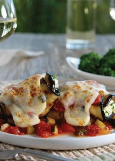 Eggplant Parm Rolls - Grilled eggplant slices filled with cheese and herbs, baked in a chunky vegetable tomato sauce.