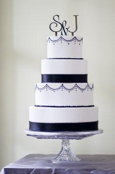 An elegant black and white wedding cake.