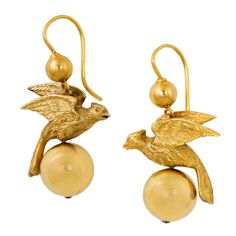 Rare Victorian Gold Bird Earrings. These birds earrings capture the best of the Victorian era, combining the beauty of the natural world with the symbolism of hope. Bounded on each side by 18k gold orbs, these delicate earring set adds a touch of beauty to the everyday.