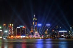 Lazers light up the sky above Victoria harbour in Hong Kong on December 31, 2012 just a few hours ahead of a midnight countdown and fireworks display.