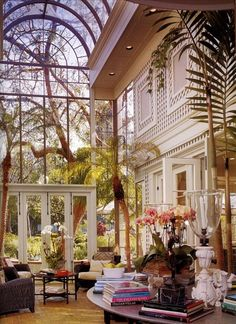 Super tall solarium with extensive latticework and potted palm trees