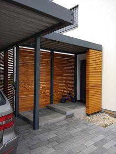 Design Metall Carport mit Vordach aus Holz Stahl Paris Frankreich Stahlzart Detail-Vordach Metallcarport Stahlcarport Doppelcarport