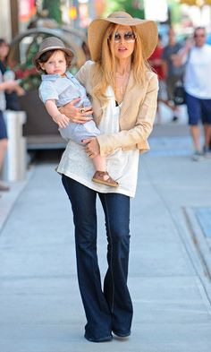 Rachel Zoe- My type of style! Big, floppy hat, silk, flowy shirt with a fitted jacket and bell-bottoms! So saturday afternoon