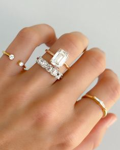 Crescent Solitaire With Emerald Cut (North South)
