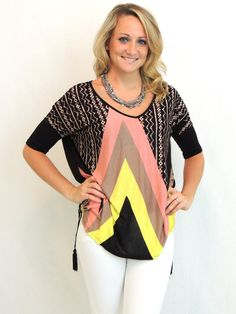 Easy Rider Top $35.00 With the wind at your back, the Easy Rider top will lead you down any new road. Free flowing fit, side slit, and tassel details make this one of a kind! Pair with your fav broken-in jeans or leather skinnies and ankle boots!