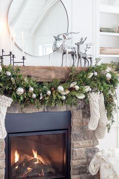 5 tips for the perfect Christmas Garland - The Lilypad Cottage - Silver Reindeer Christmas rustic fireplace mantel - Diy Christmas Fireplace, Farmhouse Christmas Decor, Christmas Mantels, Christmas Home, Christmas Holidays, Reindeer Christmas, Christmas Villages, Victorian Christmas, Vintage Christmas