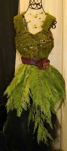 A fun dress form decorated with moss and cedar used in our booth for the bridal show.