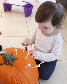 """A fun little activity to try before throwing out those carved pumpkins 🎃 Golf tee and a play hammer! We nailed the tees all the way through then pull them partially back out to make it easier for Em. She kept saying """"I hammer like dad! Baby Learning Activities, Autumn Activities, Sensory Activities, Toddler Activities, Cool Baby Gadgets, Carved Pumpkins, Toddler Costumes, Cool Baby Stuff, Pumpkin Carving"""