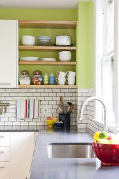 Open Shelves, bright colors, subway tiles: I am a sucker for subway tiles. It is amazing how a such a simple shape in that staggered format can elevate even the most basic materials.