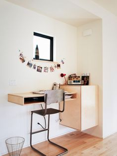 Appealing natural light brown varnished wooden corner table wooden storage cabinet wooden floor white stained plastering wall grey chrome metal chair frame black aluminium frame ventilation window