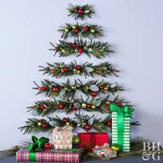 Looking for Christmas decoration for small space. Then you should definetly put up a wall Christmas Tree. Here are best DIY Wall Christmas tree ideas. Office Christmas, Christmas Fun, Christmas Wreaths, Christmas Ornaments, Ball Ornaments, Christmas Lights, Hanging Christmas Tree, Xmas Tree, Deco Floral