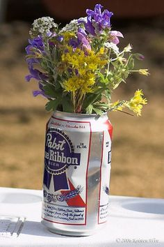 Another idea for decorations and a good way to go green (By re-using cans, not turning green from drinking too much) at your wedding!