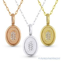 The featured pendants are cast in 14k gold (avail. in rose, white, or yellow gold) and showcase matte-finish oval inner-frames with diamond-encrusted ovals in the middle.