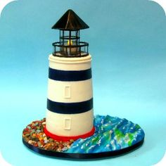 This lighthouse has a real light inside, on top of a cake column, standing on a sugar sea and flanked by chocolate rocks. Lighthouse Cake, Lighthouse Wedding, Chocolate Rocks, Edible Creations, Pretty Cakes, Custom Cakes, Cupcake Cakes, Cupcakes, Dahlia