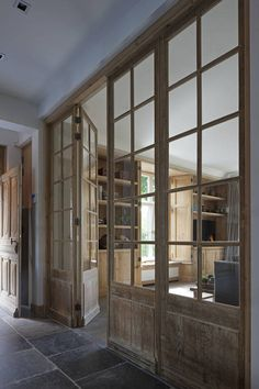 Floor and glass wal with doors. A great way to break up a long space yet keep it visually open.
