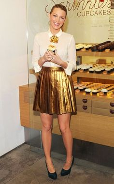 Blake Lively wearing Gucci shirt pin  http://www.vogue.com/fashion/10-best-dressed/10-best-dressed-week-of-december-26-2011/#