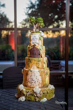 Once Upon a Time Wedding Cake Designed by Betty Janes Bakeshoppe in the Horizon Room at Sonterra Country Club.
