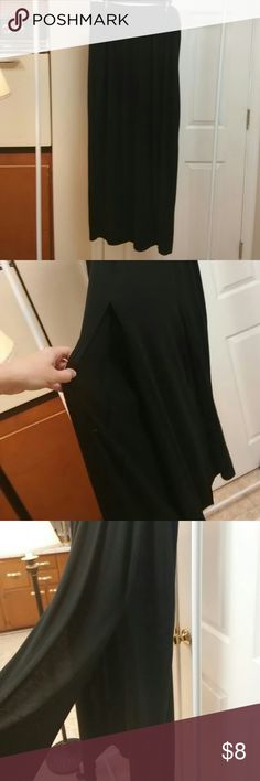 Long Black Skirt with Sexy Slits Long Black Skirt to feet, good for y'all woman or to wear with heels, Long Slits on both sides on the front of the skirt. Seems like cottonish material, but it is actually a blend of polyester, rayon and spandex. I dont think I ever wore this skirt. May have worn it once. In like new condition by Bongo. BONGO Skirts Maxi