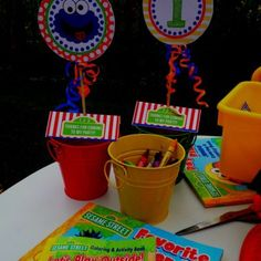 Entertain guests at an Elmo birthday party with a variety of activities such as coloring books, stickers, or blocks creatively displayed.  See more Elmo birthday party ideas at www.one-stop-party-ideas.com