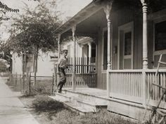 """Messenger boy delivering messages to a """"crib"""" in San Antonio's red light district, 1913."""