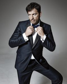 Harry Connick, Jr. in a single-breasted, three-piece navy wool tuxedo by Thom Sweeney for Mr Porter