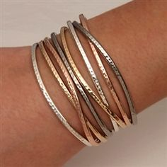 Handcrafted thin cuff bracelets from David Smallcombe - sterling silver, 14k yellow gold filled, and 14k rose gold filled hammered cuff bracelets – David Smallcomb